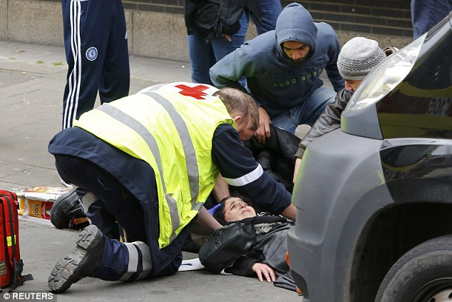 Horrific !! Muslim woman is mown down by grinning far-right activist who then stops to take a PICTURE during anti-Islam rally in the troubled Brussels district of Molenbeek