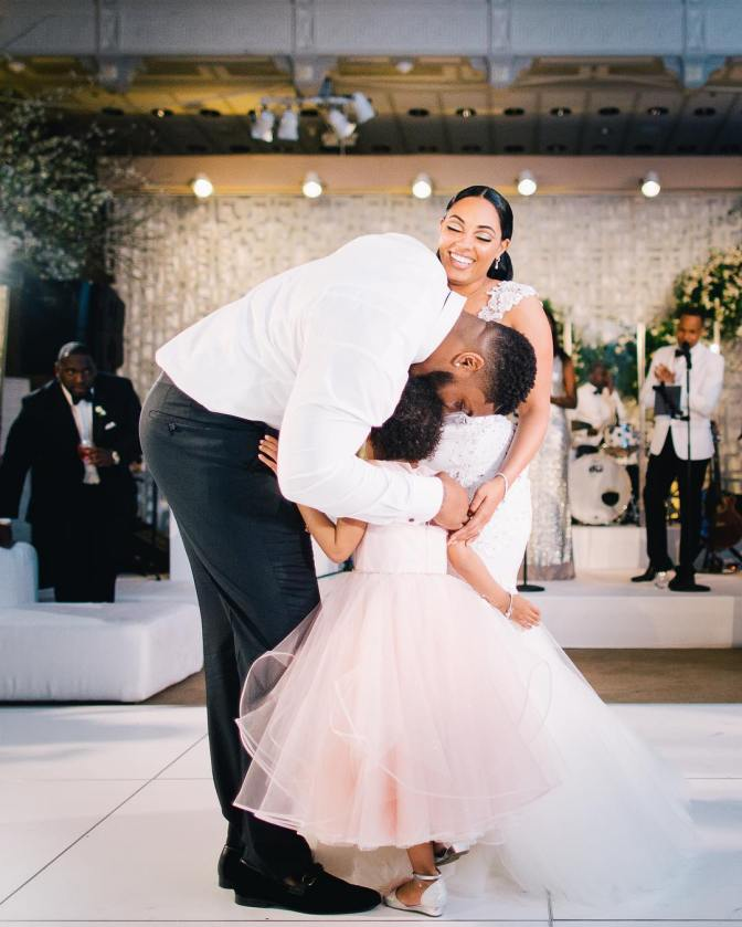 After 2 years battle with cancer, Devon Still dances with his leading ladies, wife Asha and  six-year-old daughter Leah at his wedding  that was  put on hold while she (Leah) beat cancer