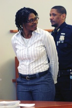 Lisette Bamenga smiles as she looks at her family at Bronx Supreme Court this morning charged with the 2012 murder of her infant and 4 year old child feeding them a toxic liquid and drowning them in her bathtub.Her trial has never been scheduled until a hearing about that today.Wednesday, January 27th,2016,Bronx,New York.(Michael,l Schwartz for New York Daily News) Police at 1805 Crotona Avenue, where a man identified as David Rivera, 23, was shot this morning and pronounced dead at a local hospital..Tuesday, November 24th,2015,Bronx, New York.(Michael Schwartz for New York Daily News).