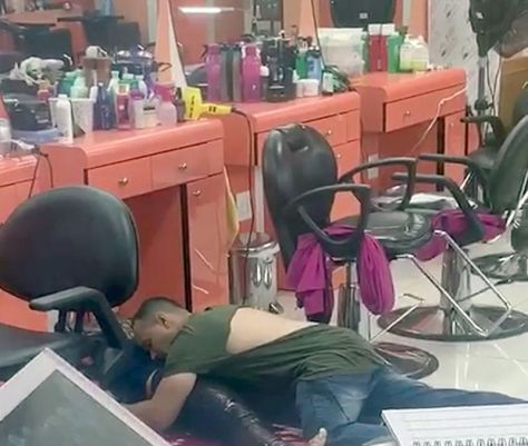 Iris Rodriguez's husband sprawls over her body after stabbing her to death in a NY beauty salon 1